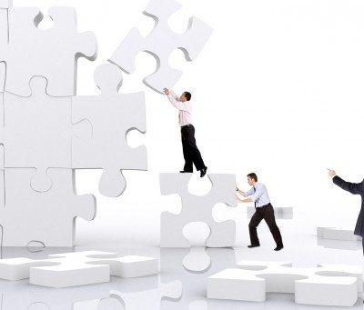 Men building puzzle